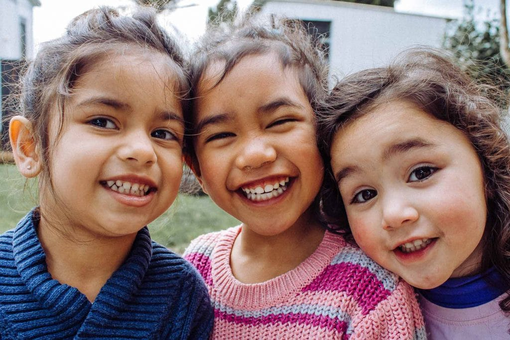3 beautiful young girls smiling