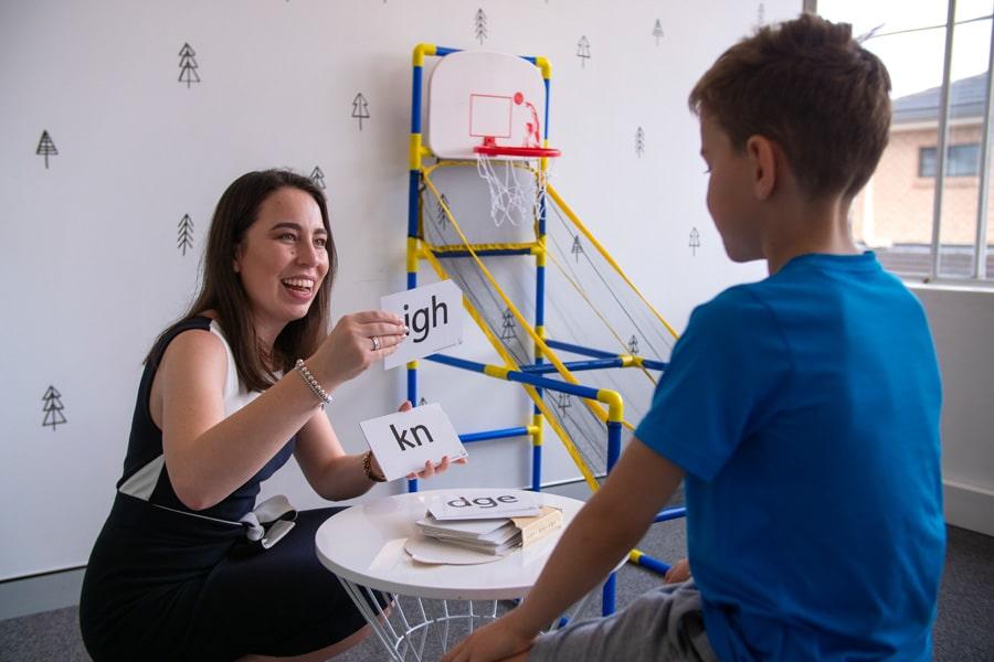Speech Pathologist showing sound cards to child